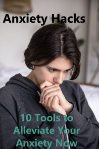Woman in gray hoody, with hair pulled back into a loose ponytail looks down with her hands folded into each other and her mouth resting on the top of her left hand. Black and Teal text reads ANXIETY HACKS 10 Tools to Alleviate Your Anxiety Now