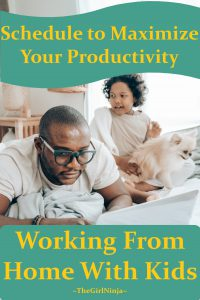 Man with glasses on laying across bed typing on open laptop balanced on the bed. Young child is on bed next to man playing with a small dog. Yellow text reads Schedule to Maximize Your Productivity Working From Home With Kids   TheGirlNinja
