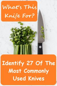 A large chef knife lays flat next to chopped green onions on a white and gray marble surface. Above green onions in top left corner of rectangle inside an orange rectangle with rounded corners white text reads What's This Knife For? Another, larger orange rectangle with rounded corners that covers green onions and the knife's black handle has white text that reads Identify 27 of the Most Commonly Used Knives