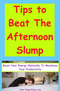 Against a sky blue background a neon yellow green box with large red text reads Tips To Beat The Afternoon Slump. Below text a brunette girl is asleep at a table in front of an open laptop. Above the sleeping girl small purple text reads Boost Your Energy Naturally To Maximize Your Productivity. Below sleeping girl small purple text reads www.thegirlninja.com